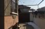 Двеутажна еднофамилна къща с търговско помещение и гараж в центъра на Благоевград