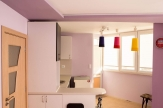 Завършен апартамент с две спални в нова сграда в широкия център на града